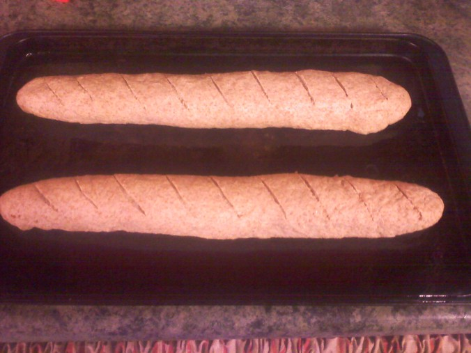 shaped into loaves with slits cut into it with a boning knife