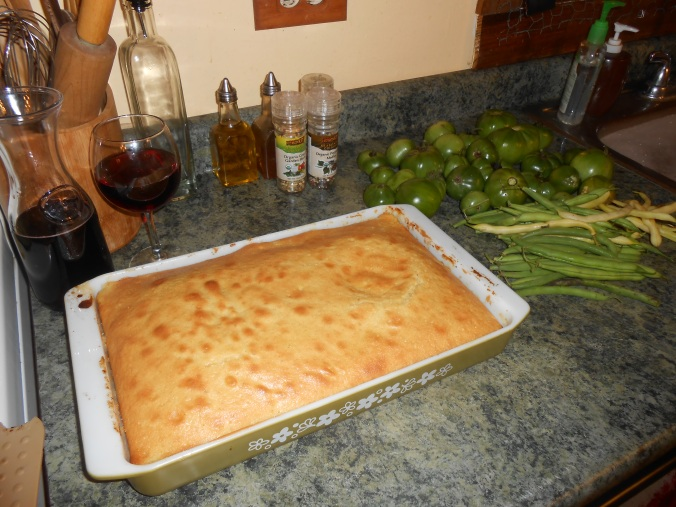 the cake cooling on counter amidst green tomatoes and snap beans from the garden, and yes I like to drink wine when I cook :D