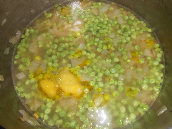 just added chicken broth to peas, check out that bright yellow fat melting in the bottom left hand corner